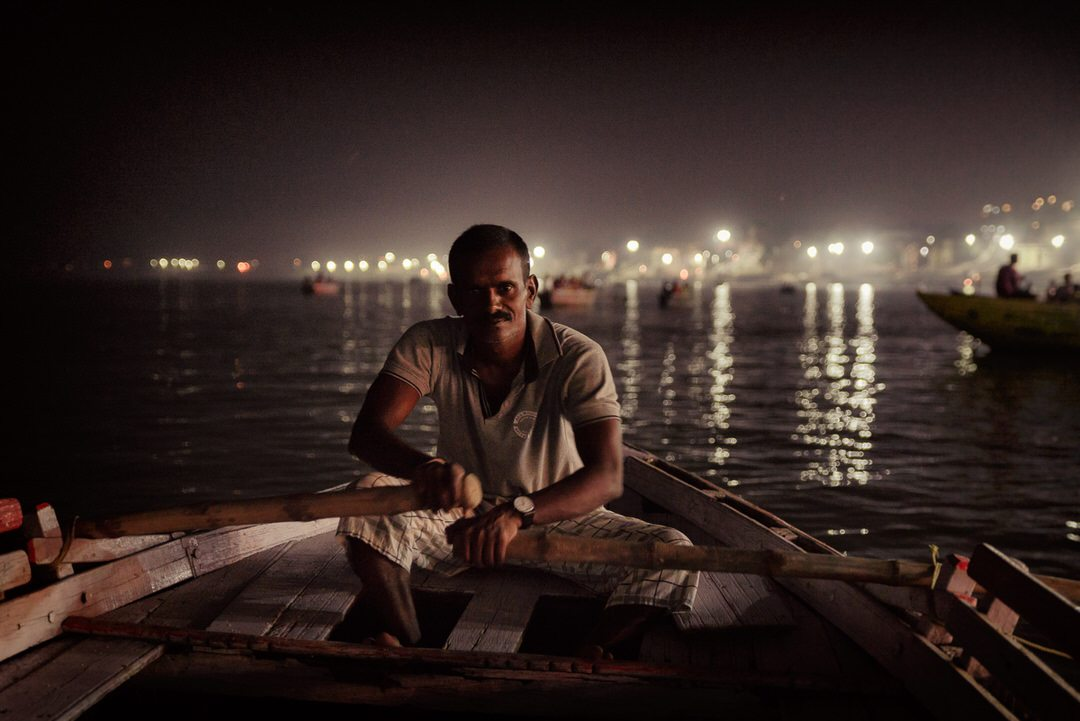 Oarsman at night, river Ganges © Hamish Scott-Brown