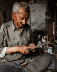 a craftsman in a shop in ladakh
