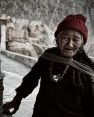 Ladakhi lady at prayer wheel, Lama Yuru monastery