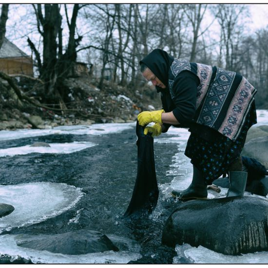 washing clothes in a frozen river, sarbi, maramures