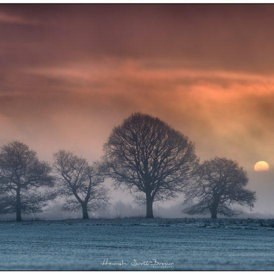 early low sun rising at flecknoe