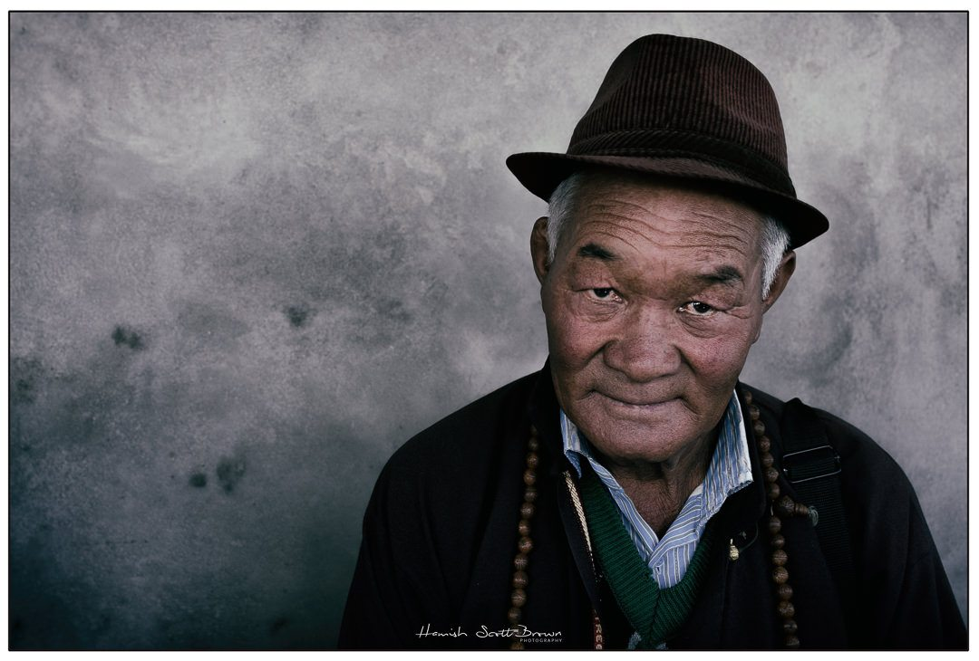 an old gentleman wearing a hat near Leh, Ladakh © Hamish Scott-Brown