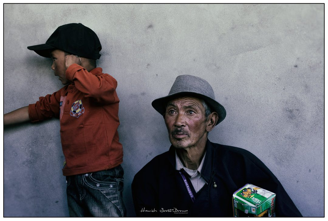 young boy with his grandfather at a buddhist festival near Leh © Hamish Scott-Brown