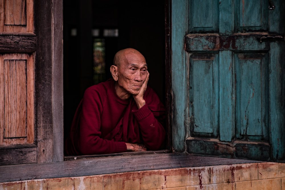 old man in a window mandalay