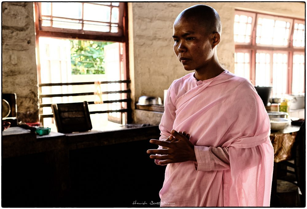 a young nun in her pink gowns in a monastery kitchen near Kalaw © Hamish Scott-Brown