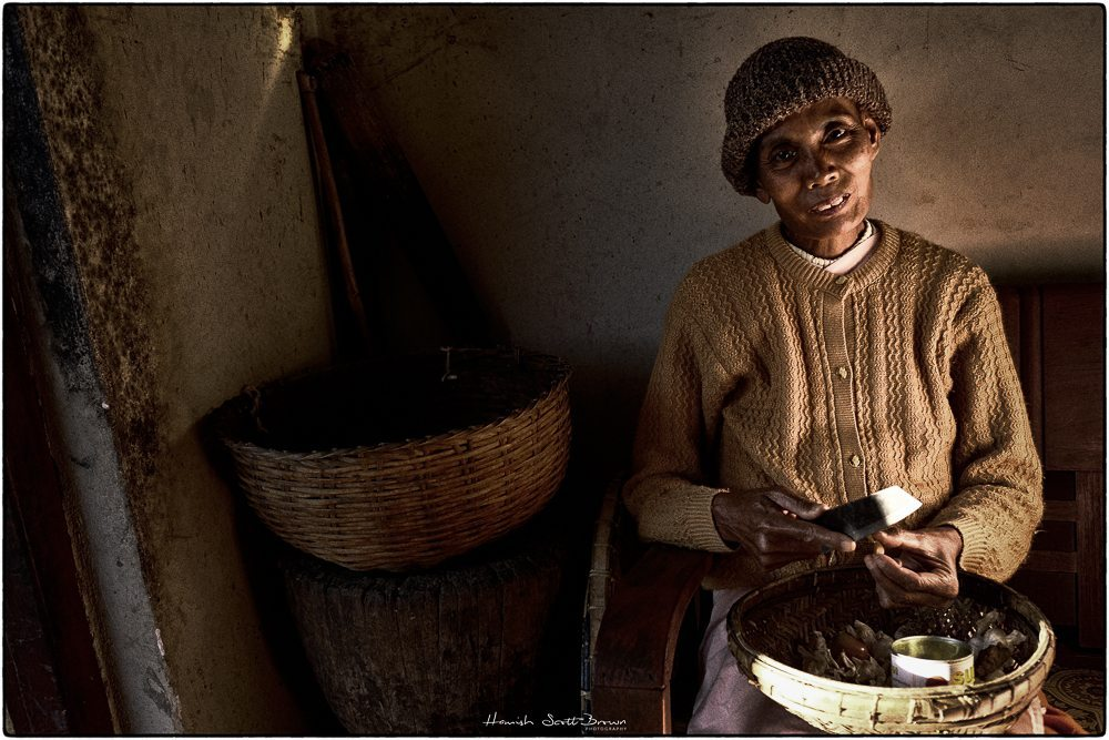 a nun prepares vegetables in a monastery lit by golden light © Hamish Scott-Brown