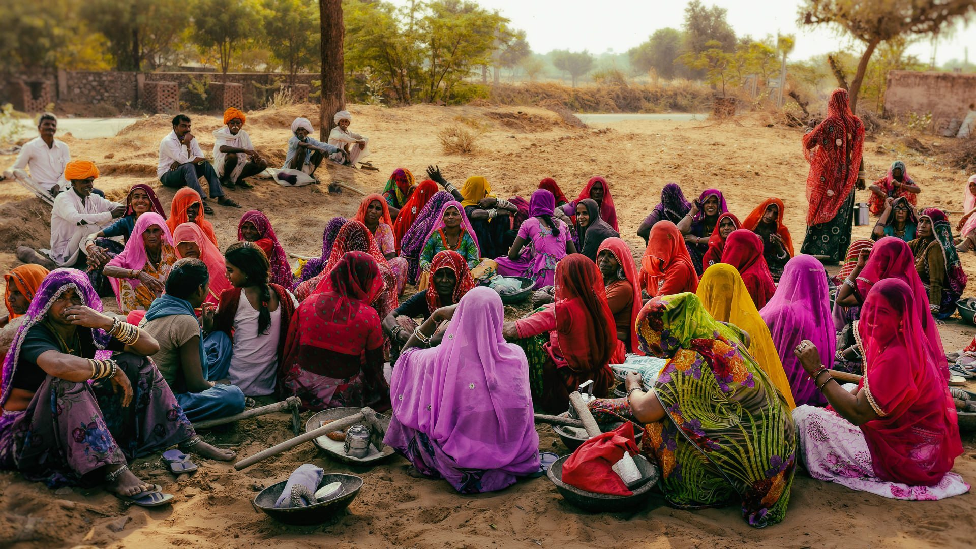 women gather in rajasthan wearing colourful red sarees © Hamish Scott-Brown