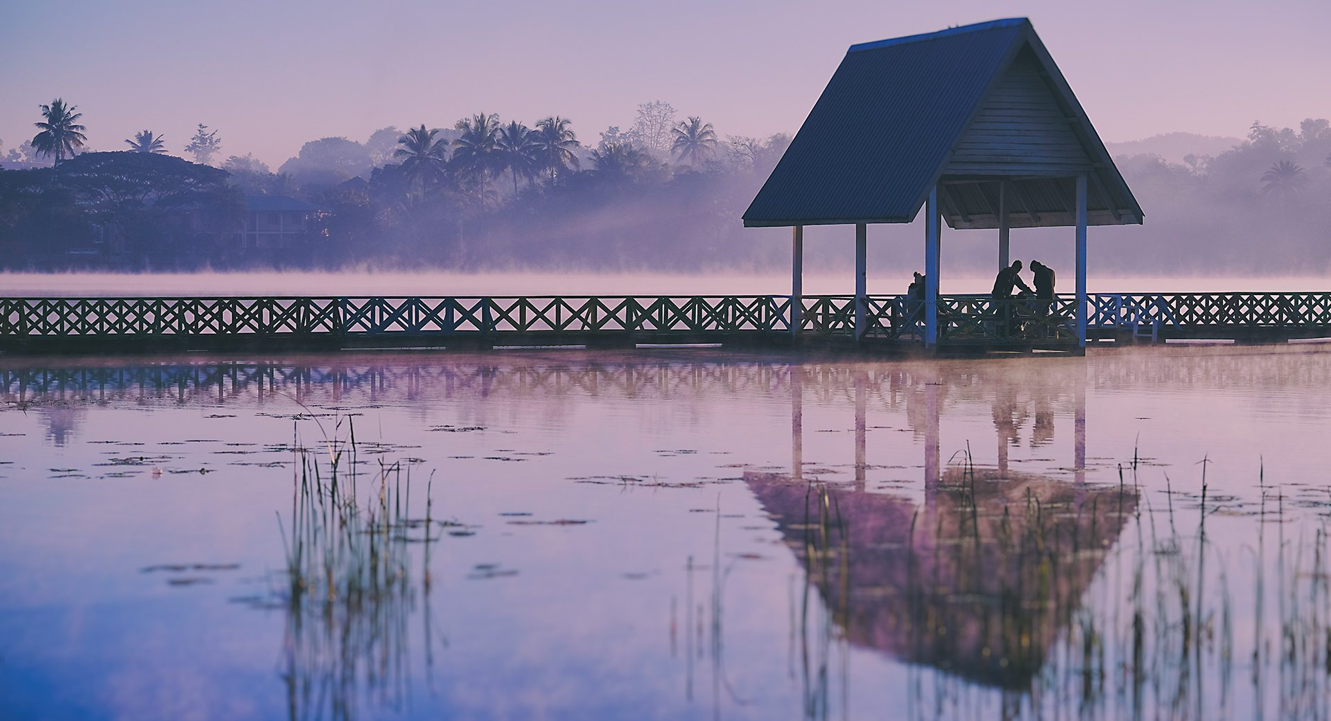dawn light and mist at a footbridge across the lake in Loikaw, Myanmar © Hamish Scott-Brown