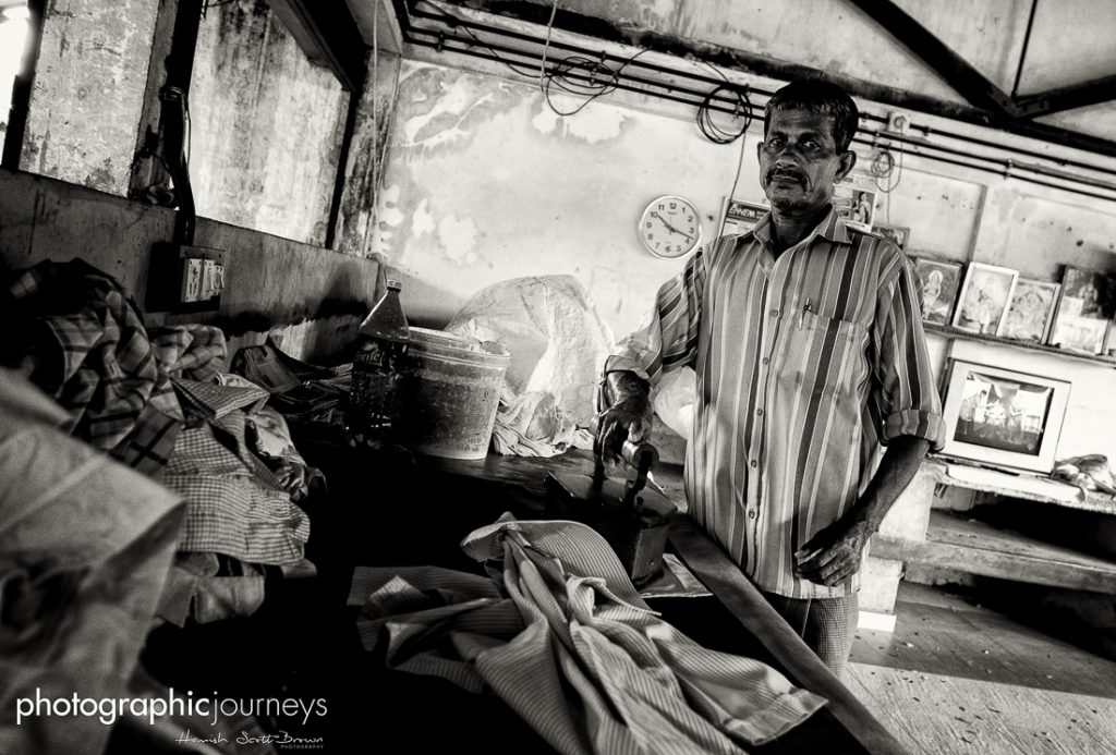 Ironing the traditional way at a dhobi in Kerlala ©Hamish Scott-Brown
