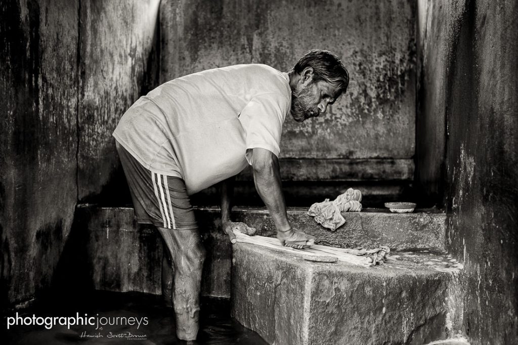 A laundry worker at the dhobi khana kerala © Hamish Scott-Brown