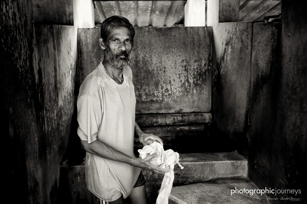 washing clothes and laundry the old fashioned way in a dhobi khana kerala © Hamish Scott-Brown