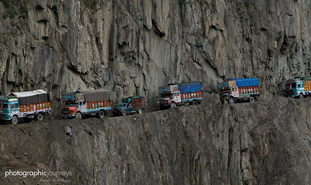 a line of trucks on a mountain road in kashmir © Hamish Scott-Brown