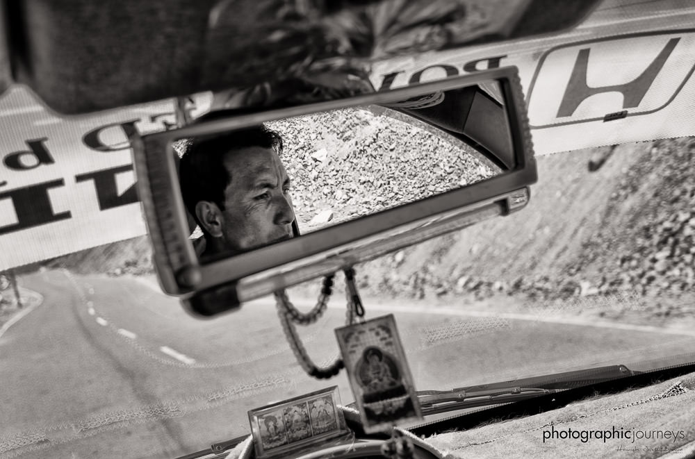 Driver in mirror on Himalayan road ©Hamish Scott-Brown