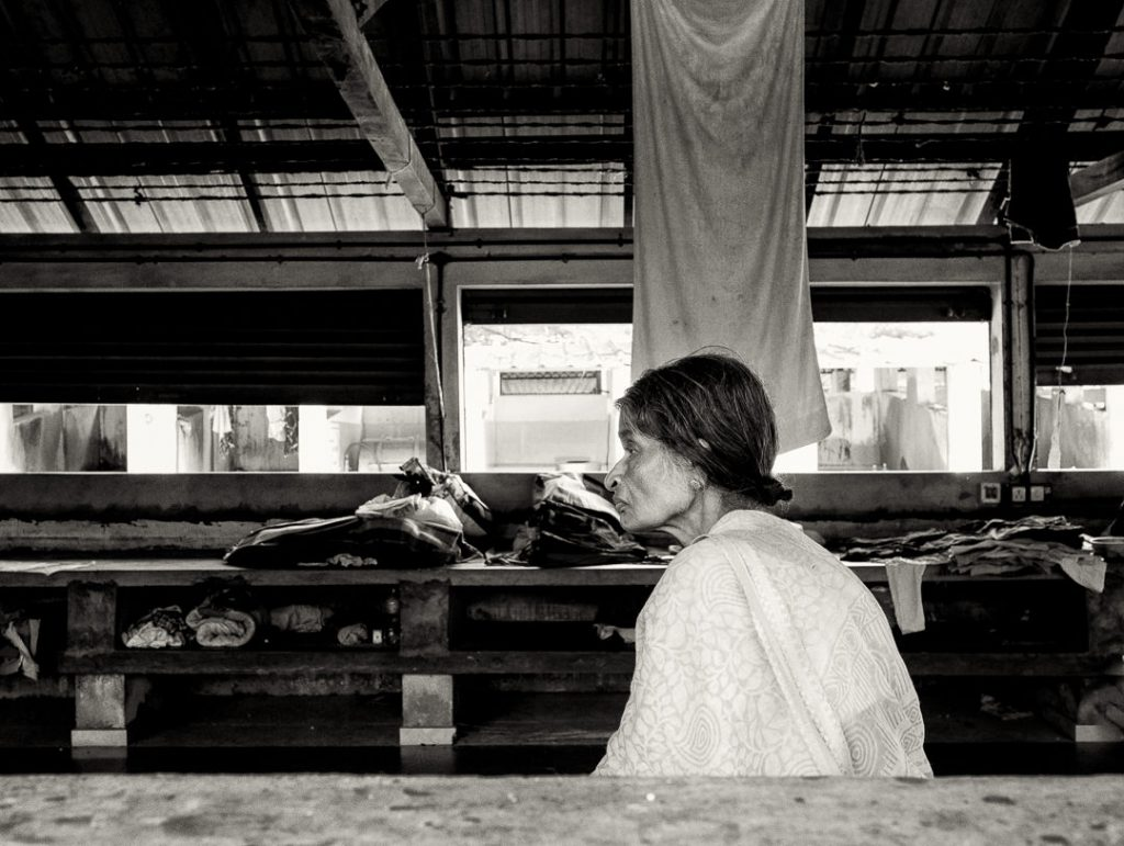 a local tamil lady waits at the dhobi khana laundry cochin © Hamish Scott-Brown