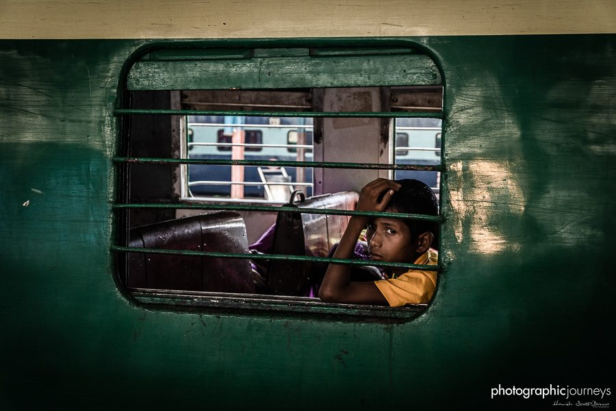 a train passenger through a window delhi station © Hamish Scott-Brown