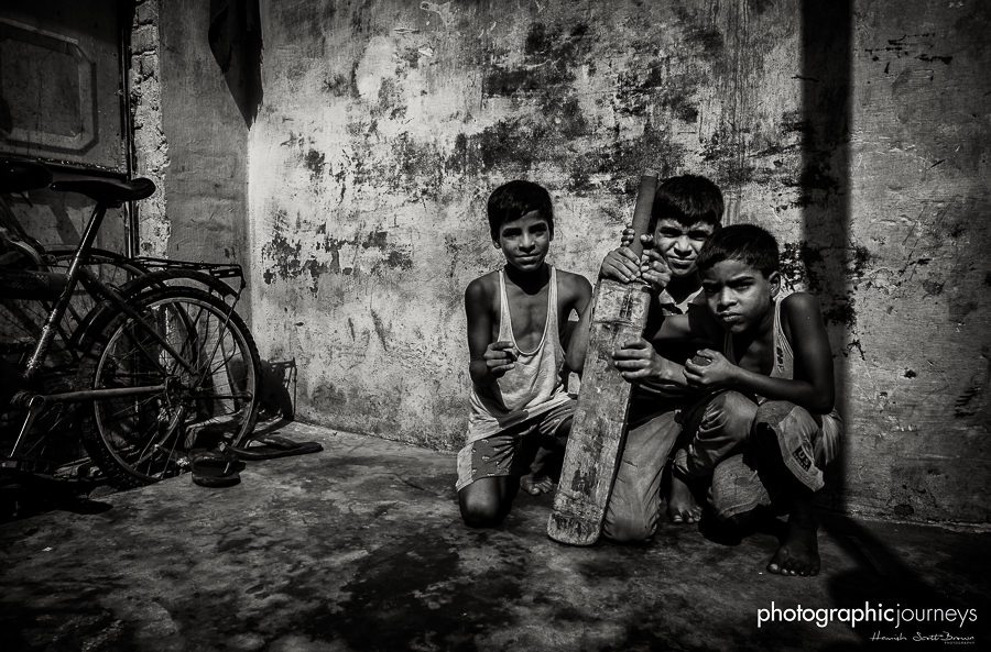 boys play witna cricket bat in a slum of jaipur © Hamish Scott-Brown