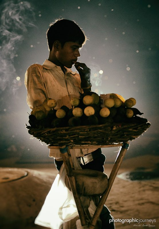 boy selling fruit at india gate © Hamish Scott-Brown