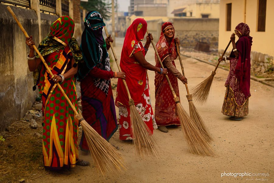 colourful sarees sweep the road at dawn in mandawa rajasthan © Hamish Scott-Brown