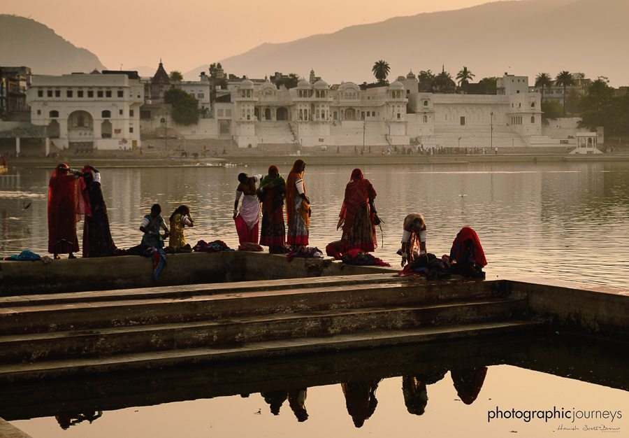 women make puja at sundown on the lake at pushkar © Hamish Scott-Brown