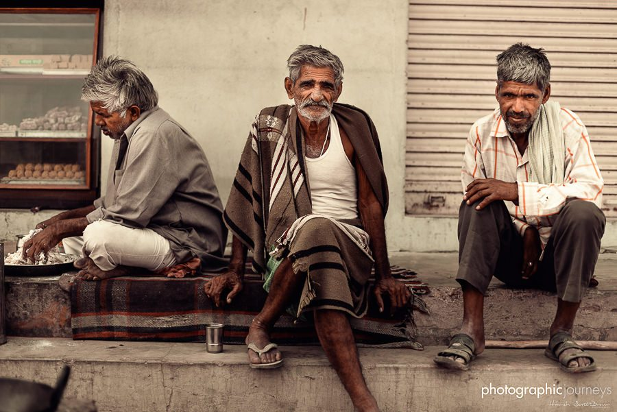 three older men sit on a step in rajasthan © Hamish Scott-Brown