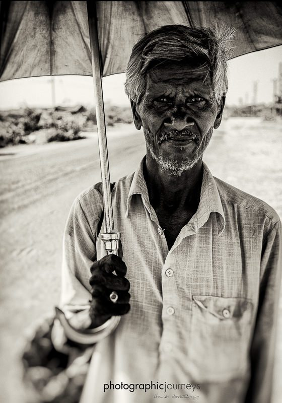 gentleman with a brolly in central Rajasthan © Hamish Scott-Brown