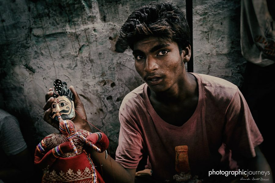 Rajasthan puppet maker holds new puppet in workshop © Hamish Scott-Brown